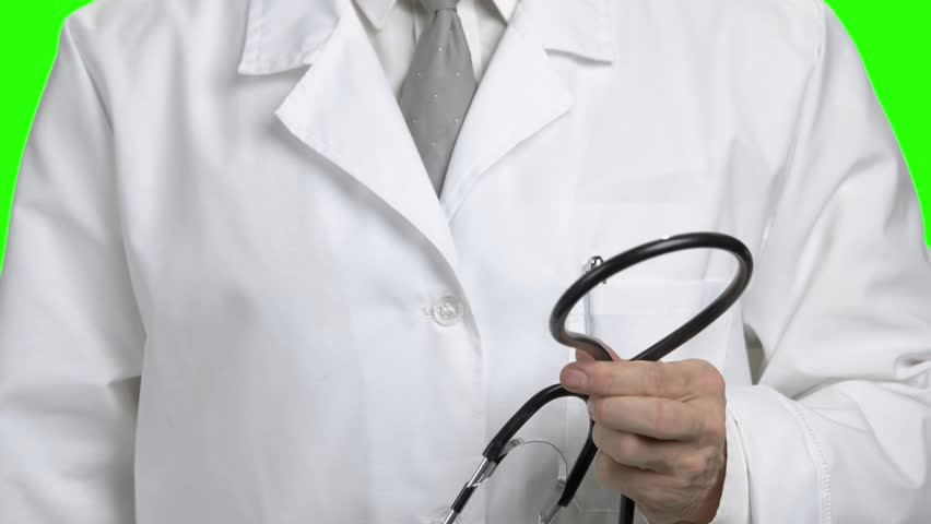 Close up doctor lays stethoscope around neck. Male doctor putting on stethoscope close up.