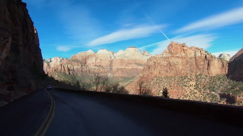 ST GEORGE, UTAH - 10 FEB: Zion National Park Utah drive cliff road POV. Southwestern desert Utah near St George. Geological landscape wind, weather and water carved spectacular beautiful mountain.