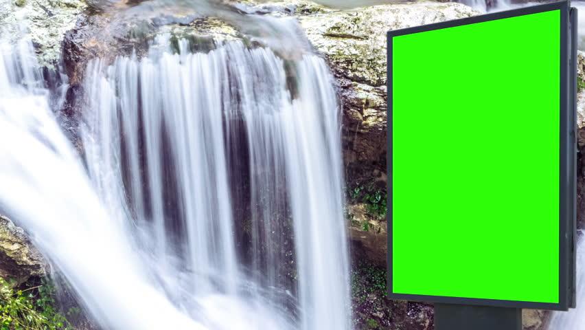 Billboard green screen near the Fabulous waterfall   Shutterstock HD Video #1007703970