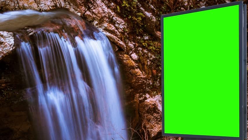 Billboard green screen near the Fabulous waterfall   Shutterstock HD Video #1007704003