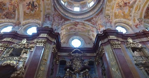 Vienna , Austria - Circa Aug 2016:Tilt Up Of The Church Interior Of Melk Abbey Austria In The Wachau Valley, With It's Ornate Gold Alter One Of The Most Important Monastic Sites In The World 4096x2160