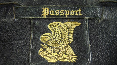 Old custom made passport leather wallet with golden eagle