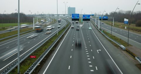 Eindhoven, Noord-Brabant / Netherlands - February 20 2018: Cars and trucks driving at busy highway