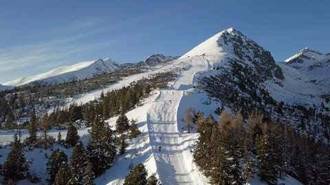 Aerial view of skiers on ski slope on Strbske Pleso resort in High Tatras mountains, Slovakia.