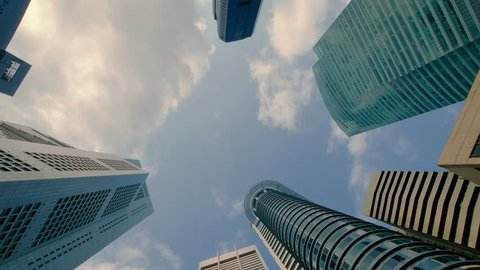 Zooming Time Lapse of Clouds Over Skyscrapers in the Central Business District of Singapore