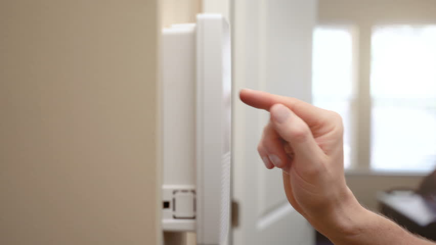 Home alarm system being activated by home owner giving the sense of security and safety.