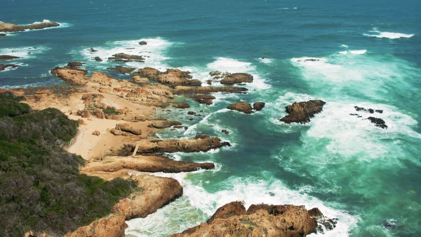 Stormy coastline of Knysna east head viewpoint with view to Loney Glen Beach