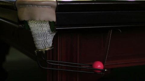 Fall of a pink ball in a pocket on a snooker table