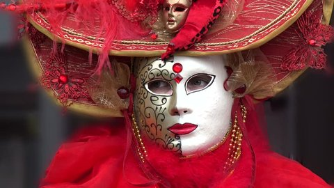 Portrait of an unidentified participant dressed up in venetian style renaissance costume and mask  at the annual festival Hallia Venezia carnival event