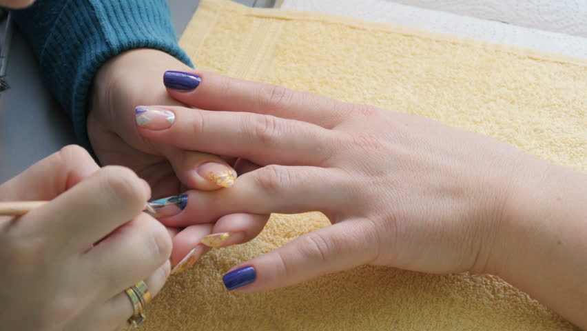 Manicure. The Master Puts On A Dark Blue Nail Polish. Hands Close-up ...