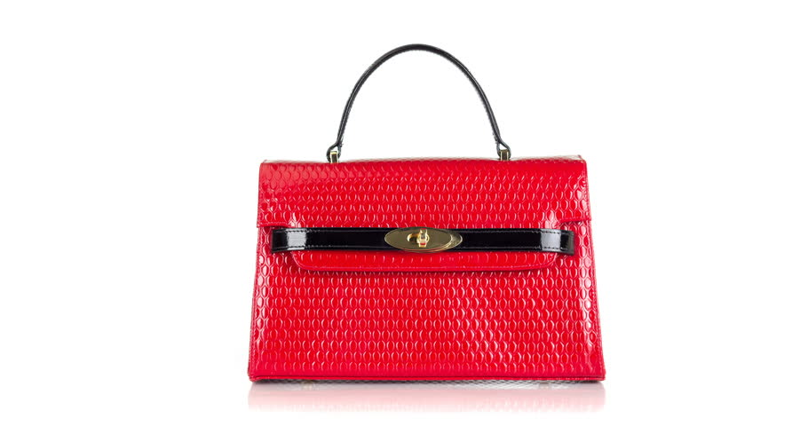 4K stop motion animation of red handbag opening up on white background