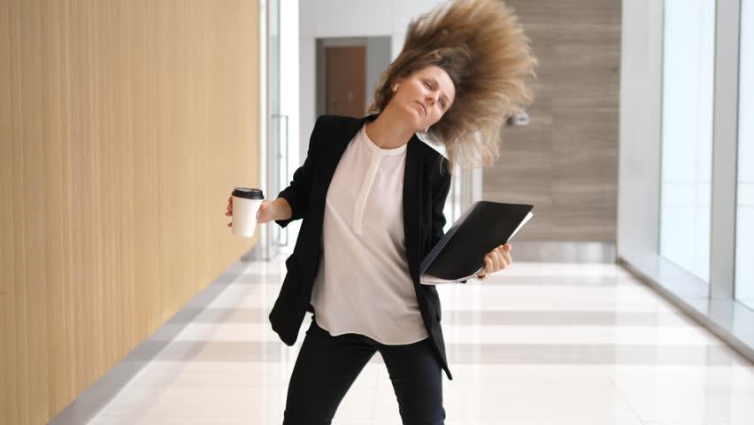 Happy Successful Businesswoman Dancing In Office Hall | Shutterstock HD Video #1007924938