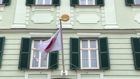 Flag of Japan waving in the wind on the embassy building in Bratislava, Slovakia