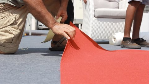 rolling a big carpet event red carpet wedding party preparations