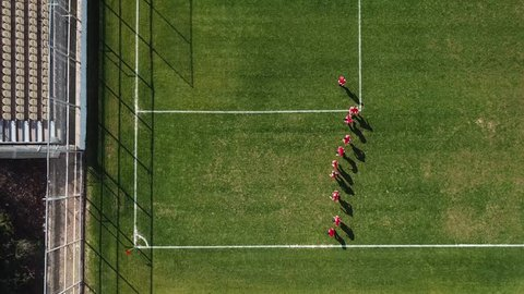 Amateur soccer players during warm up - Top down aerial footage