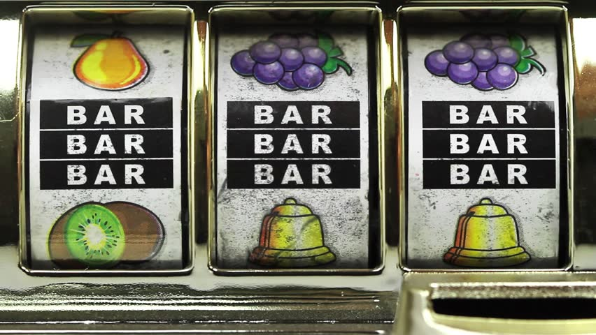 Retro slot machine spinning to 777,and BAR BAR BAR .  | Shutterstock HD Video #1008012538