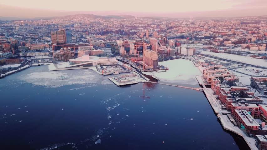 Aerial shot (camera tilting upwards) of the new Munch museum Lambda in Oslo, Norway at sunset  | Shutterstock HD Video #1008013618