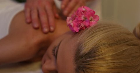 Beautiful Woman Getting a Good Massage in Therapy Room Spa Beauty Health Center