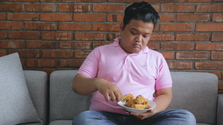 Portrait of fat male asian thinking about diet