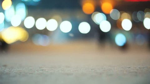 Abstract winter background. Night skating rink in a defocus with blurred round lights. Winter scene