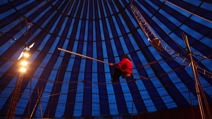 Tihtrope walker performing in the circus tent