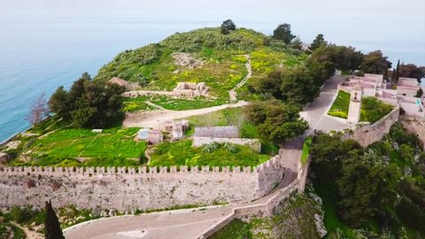 Aerial drone video from picturesque and famous fortress of Acronafplia with views to iconic city of Nafplio former capital of Greece, Argolida, Peloponnese