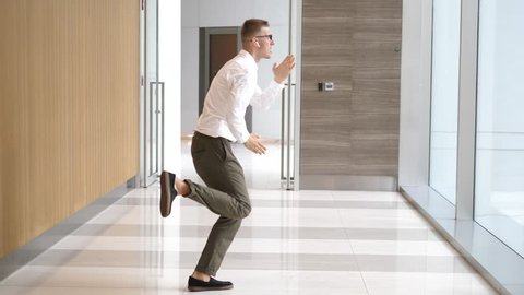 Happy Successful Businessman Dancing In Wireless Earphones