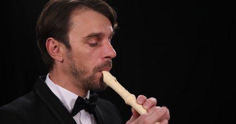 Mature Flutist Man Playing Recorder Flute Instrument Orchestra Music Performer