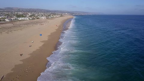 Aerial view of waves crashing on the beach. Newport Beach, California