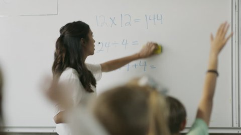 Panning shot of teacher questioning students in math class / Provo, Utah, United States