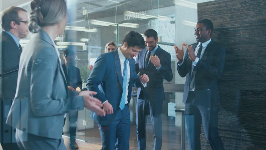 Diverse Group of Business People Celebrate Closing of the Deal and Dance. Funny and Friendly Theme. Shot on RED EPIC-W 8K Helium Cinema Camera.