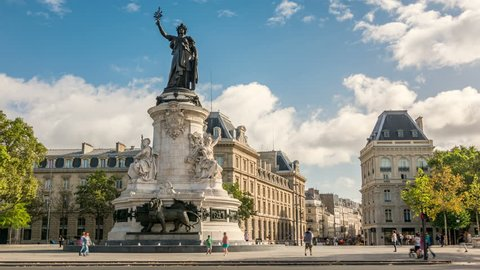 Bronze statue of Marianne with an olive branch in her right hand. Place de la Republique, Paris, France. Time