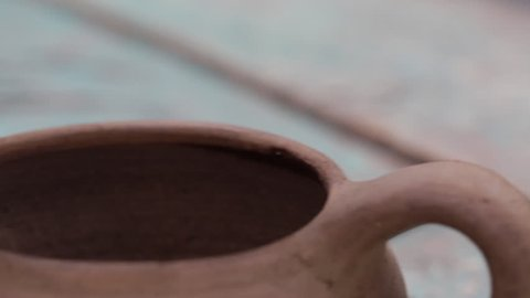 Mud Cup on Wooden Table