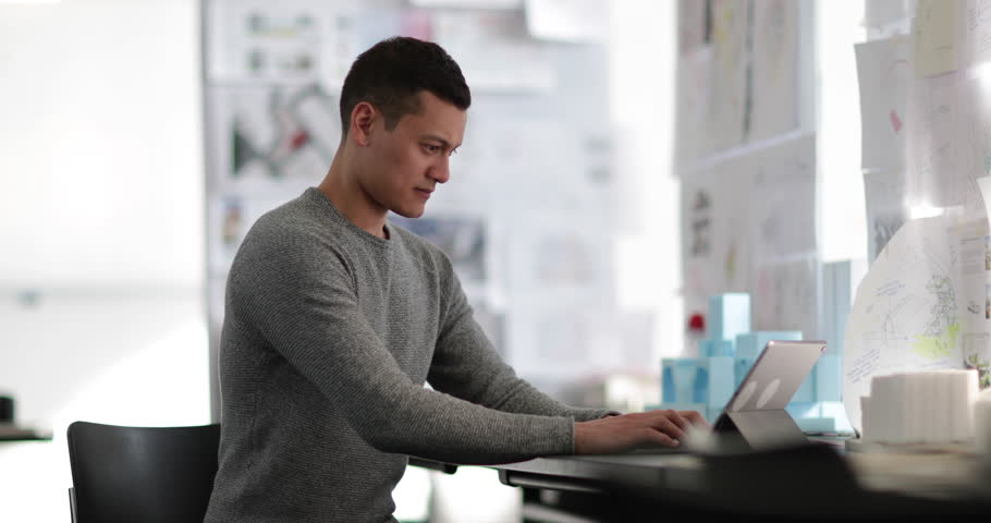 Young adult male working in creative office | Shutterstock HD Video #1008340978