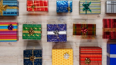 Lots of wrapped presents moving through screen in lines - variety of gifts for christmas or other occasions