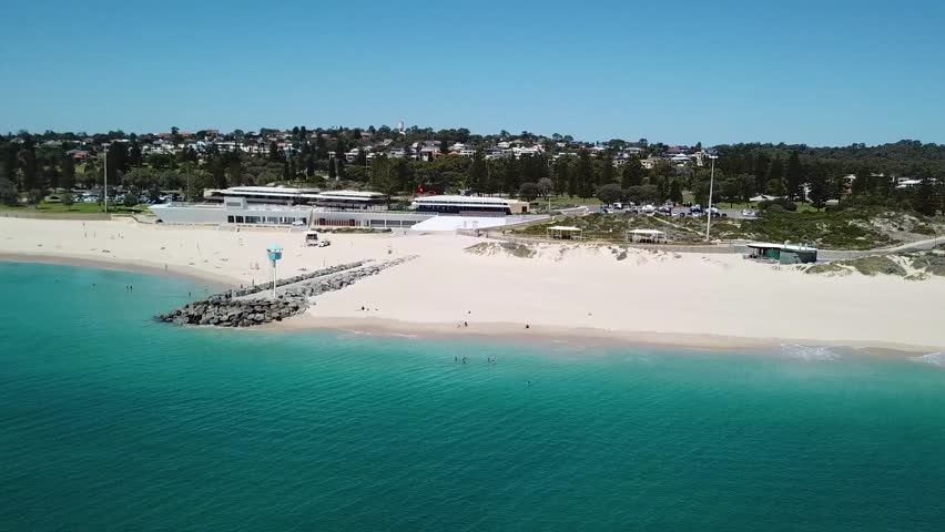 Aerial video of a Blue Baywatch House on a pier surrounded by a turquoise waters of Indian Ocean- South City Beach, Western Australia.