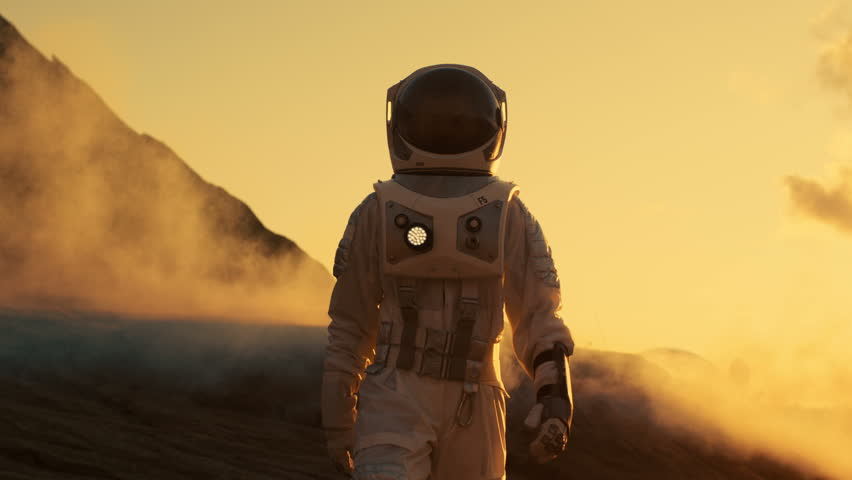 Astronaut Confidently Walking on Mars. Red Planet Covered in Rocks, Gas and Smoke. Humans Overcoming Difficulties. Big Moment for the Human Race. Shot on RED EPIC-W 8K Helium Cinema Camera. | Shutterstock HD Video #1008373408