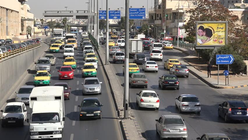 AMMAN, JORDAN - NOVEMBER 2016: Busy traffic drives through the streets of Amman in Jordan
