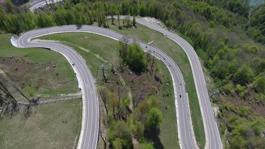 Aerial view of the ski lift above the serpentine mountain roads in Krasnaya Polyana, Sochi, Russia.