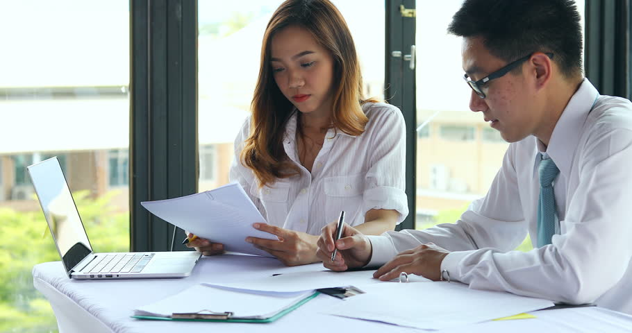 Asian business man and woman busy working team consult planing in smart office | Shutterstock HD Video #1008397138