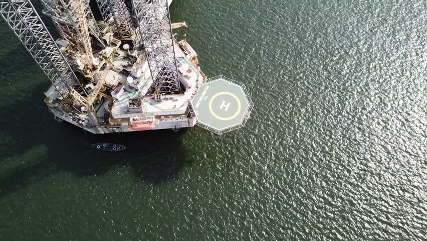 Aerial shot of engineering oil rig with helipad