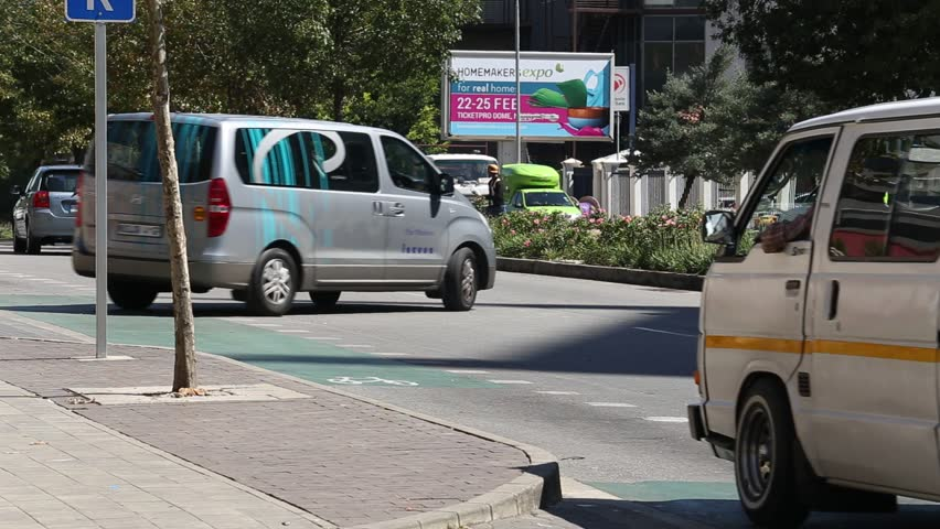 Johannesburg, South Africa - March 8, 2018: People getting out of a minibus taxi.
