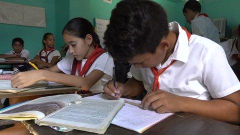 TRINIDAD, CUBA - FEBRUARY 2017: Curious elementary school students at work in classroom Trinidad, Cuba