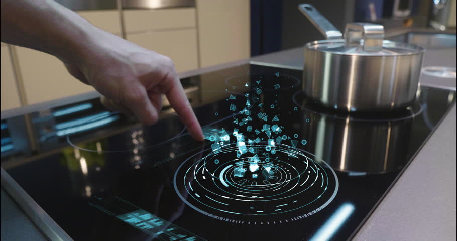 Close up of a man who cooks in his own home on a stove of the latest technology and regulates power and intensity thanks to holography. Concept of: future, technology, kitchen, augmented reality. | Shutterstock HD Video #1008523858