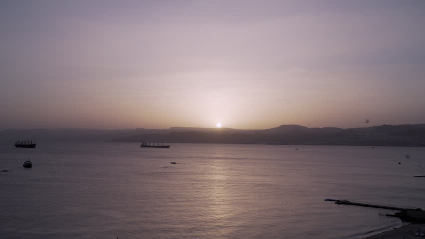 Ships Anchored on the Red Sea at Sunset in Jordan    Shutterstock HD Video #1008533908