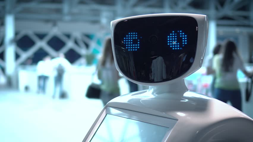 MOSCOW RUSSIA - 04.04.2017: Modern Robotic Technologies. The robot looks at the camera at the person. The robot shows emotions. The robot looks at the camera at the person. | Shutterstock HD Video #1008541918