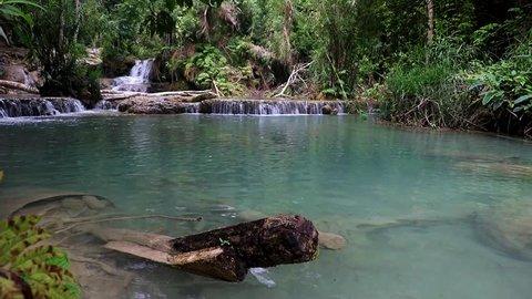 Lagoon with water cascade in tropical jungle. The Kuang Si Falls, known as Tat Kuang Si Waterfalls Luangprabang, Laos.