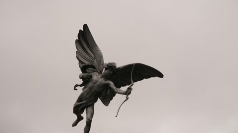 Bronze Eros statue located on Piccadilly Circus in London, Uk, 4k, slow motion