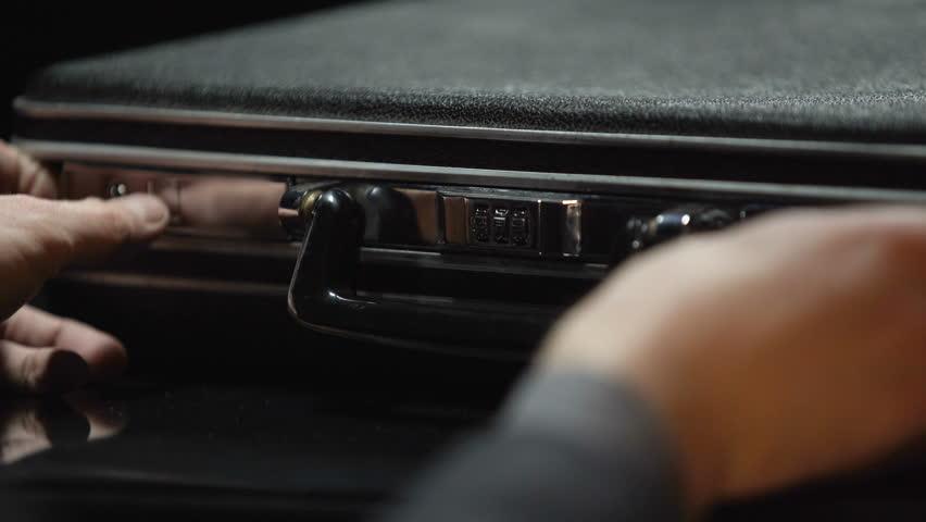 Oligarch hides cash money into suitcase, secret stash, no trust to bank, closeup | Shutterstock HD Video #1008573178