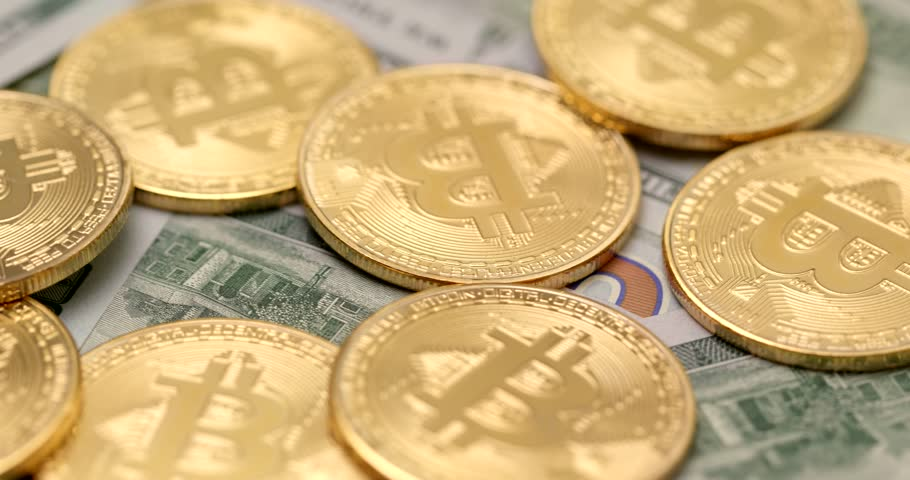 Golden Bitcoin and USD in rotation | Shutterstock HD Video #1008623548